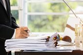 Businessman Hands Holding Pen For Working In Stacks Of Paper Files Searching Information Business Re poster