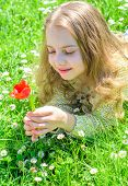 Tenderness Concept. Girl On Calm Face Holds Red Tulip Flower On Sunny Spring Day. Child Enjoy Aroma  poster