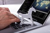 Hacker Hacking Global Network With Trojan Horse Icon On Laptop poster