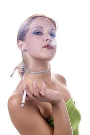 stock photo of street-walker  - blond sexy model smoking a cigarette - JPG