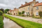 Quaint cottages and stream in an English village