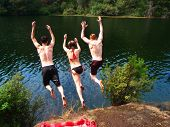 foto of summer fun  - Summer fun swimming at the lake on a hot day - JPG