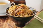 stock photo of lo mein  - a bowl of beef lo mein near a take out container - JPG