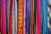 Shawls hanging at the outdoor craft market in Otavalo