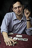 Young Man With Cigar Playing Poker