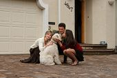 picture of dog-house  - happy family with a dog in front of the home - JPG