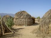 pic of mud-hut  - poor huts in a remote village in the desert - JPG