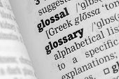 stock photo of glossary  - Glossary Dictionary Definitione single word close up - JPG