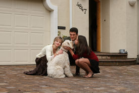 foto of dog-house  - happy family with a dog in front of the home - JPG