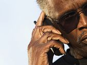 Senior man wearing sunglasses speaking on phone