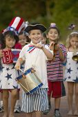 stock photo of citizenship  - Portrait of children in 4th of July parade - JPG