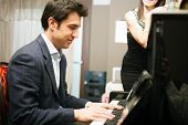 foto of serenade  - Man playing piano for his girlfriend - JPG