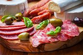 stock photo of cheese platter  - Salami catering platter with different meat and cheese products - JPG