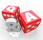 The letters Q & A on red dice to symbolize questions and answers to customer questions or assistance