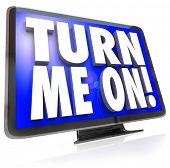 An HDTV television with words Turn Me On telling you to watch the cable satellite or broadcast TV fo