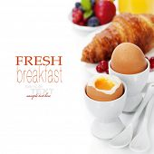 stock photo of croissant  - Delicious breakfast with eggs - JPG