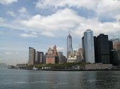 NEW YORK - MAY 7: Buildings in lower Manhattan are shown from a Staten Island Ferry as it prepares to dock at Whitehall Terminal, South Ferry on May 7, 2013 in New York City.