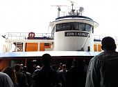 NEW YORK - MAY 7: Commuters walk towards the John F. Kennedy Staten Island Ferry at Whitehall Termin