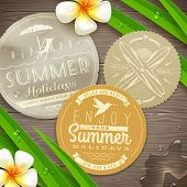 Vintage paper labels with vacation and travel emblems and tropical flowers on a wooden surface - vec