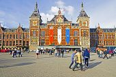 AMSTERDAM, NETHERLANDS - APRIL 30: Decorated central station in Amsterdam Netherlands on occasion of
