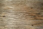 foto of lumber  - Photo of a rough wood board from a rustic old barn - JPG