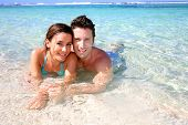 Portrait of cheerful couple in Caribbean sea