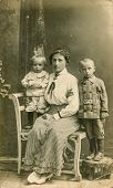 POLAND, CIRCA 1910, vintage photo of mother with son and daughter, Poland, circa 1910