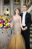 Beautiful couple in elegant dress next to a bouquet of flowers