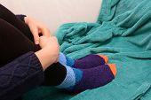 Woman Hugging Her Legs, Wearing Warm Socks