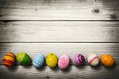 stock photo of small-flower  - Easter eggs on wooden background - JPG