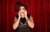 picture of drag-queen  - Uncertain drag queen with hands on face - JPG