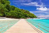 Pier to the tropical island in Thailand
