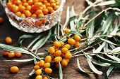 stock photo of sea-buckthorn  - sea buckthorn berries on a wooden table - JPG