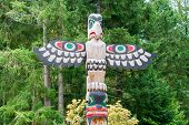 image of indian totem pole  - historic totem pole by ancient native indian americans - JPG