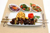 Grilled meat with potatoes and salad