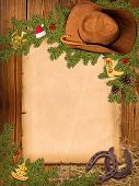 Christmas American Western Background With Cowboy Hat And Old Paper