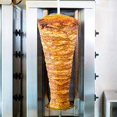 Doner kebab - hot and fresh meat skewer in Turkish fast food eatery