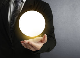 stock photo of oracle  - Businessman hand holding the Crystal Ball  - JPG