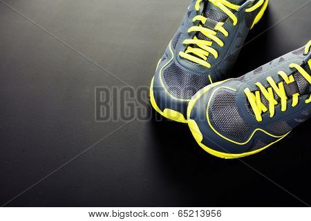 Sport shoes on grey background poster