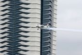 PUTRAJAYA, MALAYSIA - MAY 17, 2014: Matthias Dolderer of Germany, in an Edge 540 V3 plane flies by t