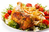 Roast chicken leg, French fries and vegetable salad