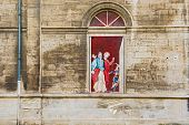stock photo of avignon  - Street view at the paintings on the wall of Opera Theatre in Avignon - JPG