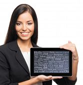 Young, confident, successful and beautiful business woman with the tablet computer with a different
