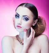 picture of ombre  - Face close up of beautiful young woman with professional party make up false eyelashes - JPG