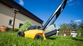 Gardening. Mowing Lawn With Yellow Lawnmower