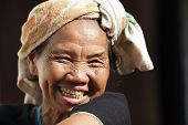 BAM MUANG PAM, THAILAND, NOVEMBER 22 : close portrait of a mature Karen tribe woman laughing, Thai e