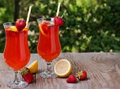 stock photo of sangria  - Fresh homemade strawberry lemonade on the table - JPG