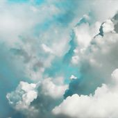Editable vector illustration of thick cumulus clouds in turquoise sky made using a gradient mesh