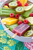 pic of popsicle  - Colorful popsicles with fresh fruits in vintage tray - JPG
