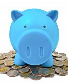 a blue piggy bank with some coins